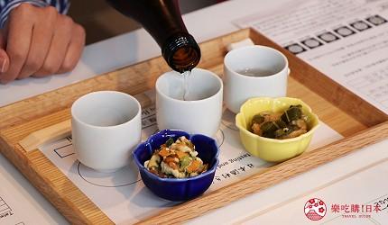 京都七條住宿推薦「HOTEL GLAD ONE 京都七條」提供的日本酒品酒體驗提供兩道下酒菜