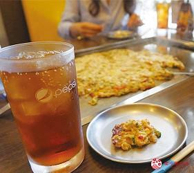 奈良用餐推荐近铁奈良站1分钟「NALALA 美食天地」的店家「元祖关西风味文字烧真田」免费赠送的乌龙茶